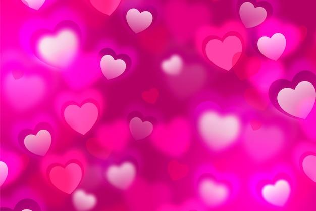 Fondo de pantalla de san valentín borrosa con corazones vector gratuito