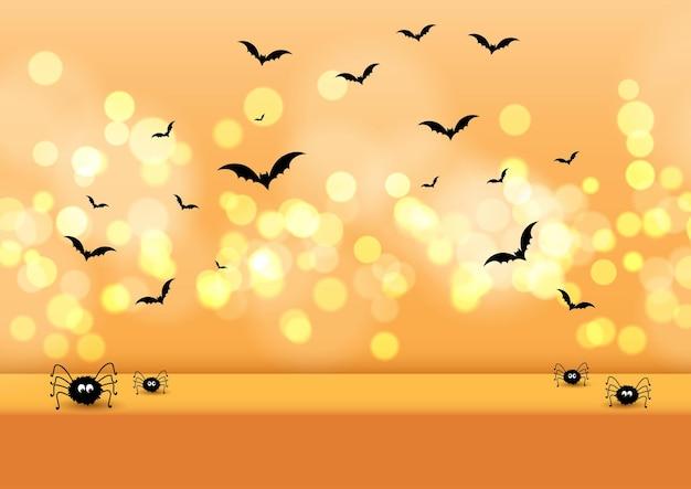 Fondo de pantalla con temática de halloween con arañas y murciélagos