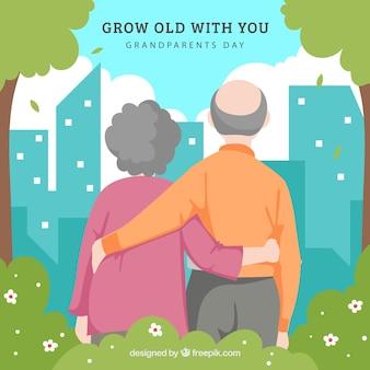 Fondo de pareja de abuelitos contemplando la ciudad