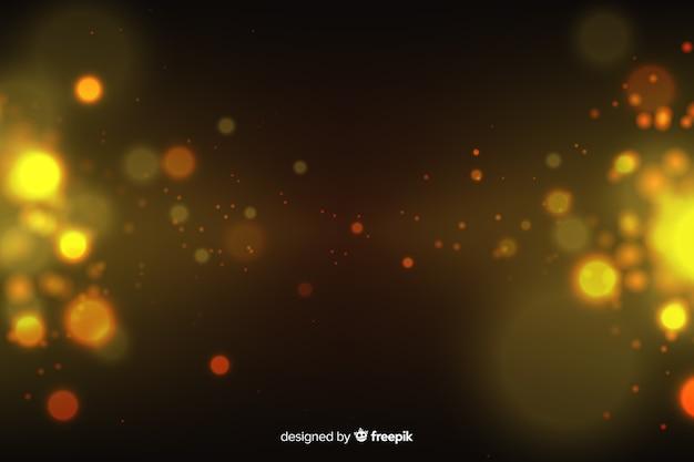 Fondo de partículas doradas en estilo bokeh
