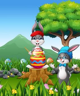 Fondo de pascua con conejitos y gran huevo de pascua.