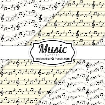 Fondo con patrón de notas musicales y pentagramas