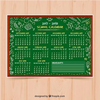 Fondo de pizarra con calendario dibujado a mano