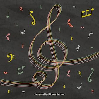 Fondo de pizarra con clave de sol dibujada a mano y notas musicales