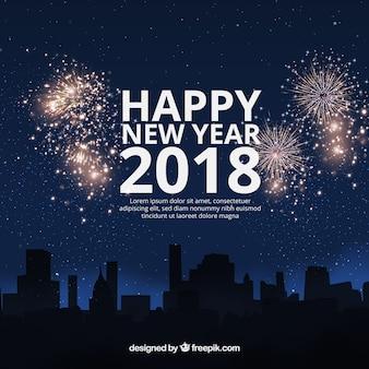 Fondo plano de año nuevo 2018 con fuegos artificiales