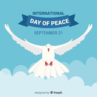 Fondo plano del día de la paz de la paloma