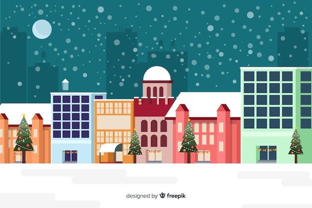 Fondo plano de navidad con edificios listos para navidad