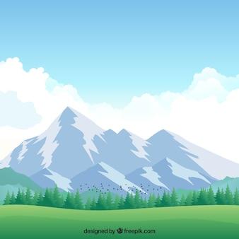 Fondo de prado con montañas nevadas