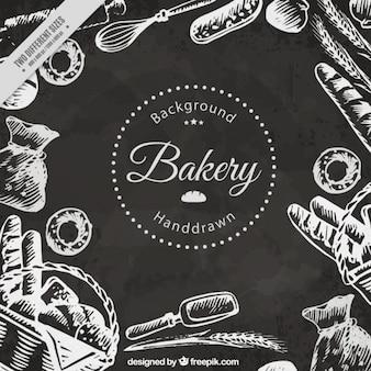 Fondo de productos de panadería dibujados a mano en efecto pizarra