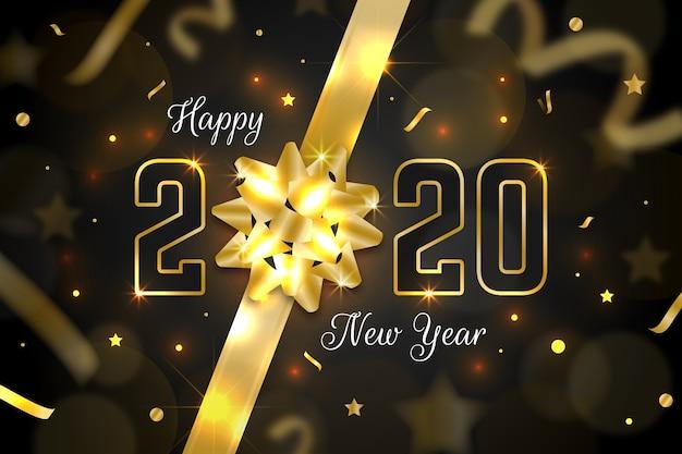 Fondo realista de año nuevo 2020 con lazo de regalo dorado