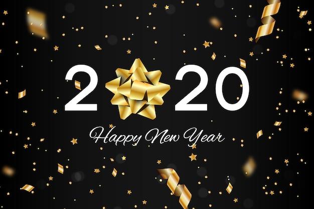 Fondo realista de año nuevo con lazo de regalo dorado