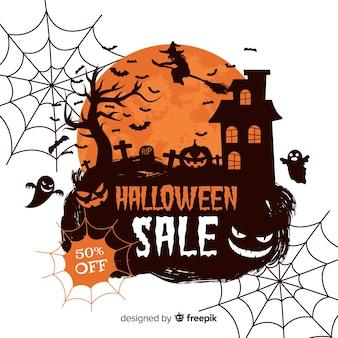 Fondo de rebajas de halloween con telas de araña