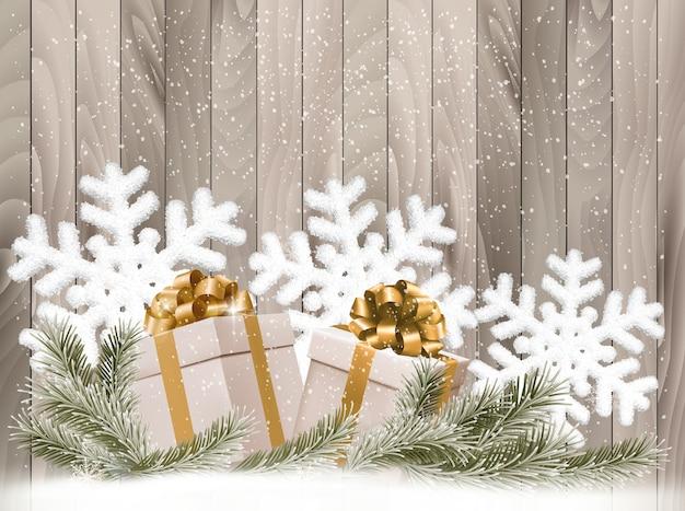 Fondo con regalos y copos de nieve.