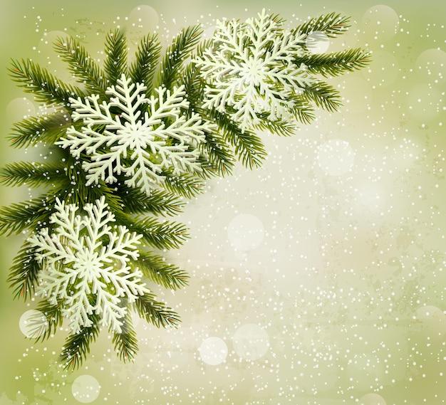 Fondo retro de navidad con ramas de árboles de navidad y copos de nieve.