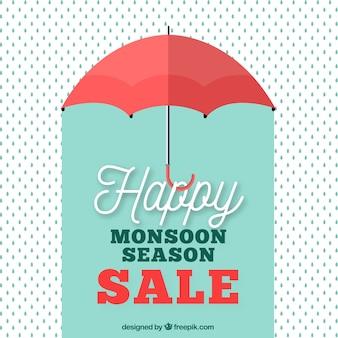 Fondo retro de rebajas de monzón con paraguas y gotas
