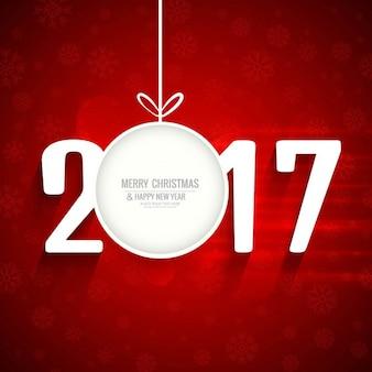 Fondo rojo de año nuevo 2017 con bola navideña
