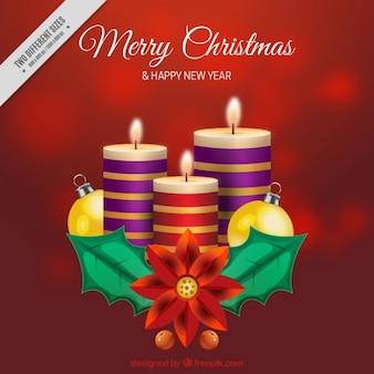 Fondo rojo desenfocado con velas navideñas