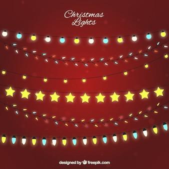 Fondo rojo con diferentes tipos de bombillas navideñas