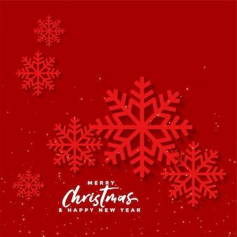 Fondo rojo de navidad con copos de nieve