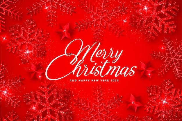 Fondo rojo de navidad con elegantes copos de nieve