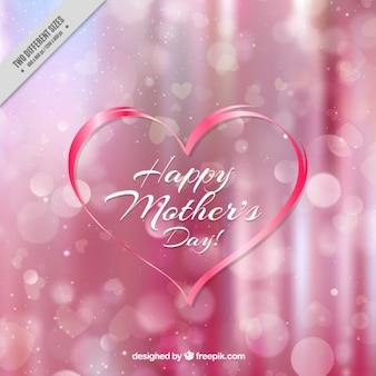 Fondo rosa borroso bokeh con un corazón