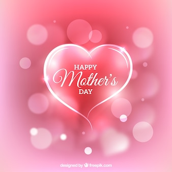 Fondo rosa con corazón decorativo y efecto borroso para el día de la madre