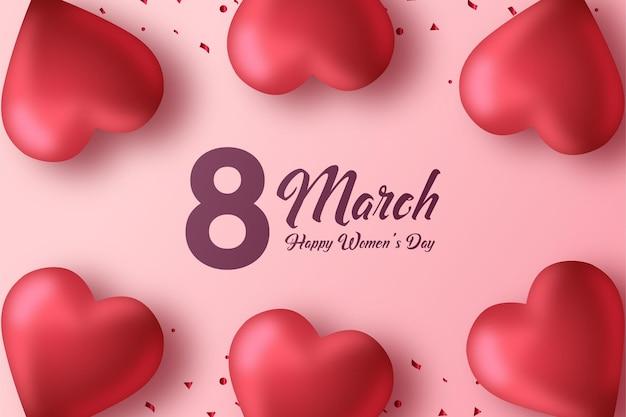 Fondo rosa para el día de la mujer con globos de amor en la parte superior e inferior.
