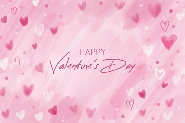 Fondo rosa del día de san valentín con corazones dibujados a mano