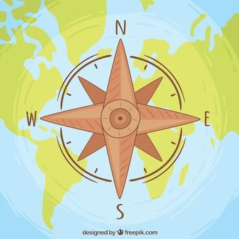 Fondo de rosa de lo vientos sobre mapa del mundo