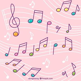 Fondo rosa de pentagramas con notas musicales de colores