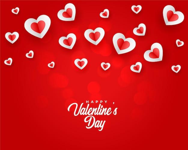 Fondo de saludo de corazón flotante del día de san valentín