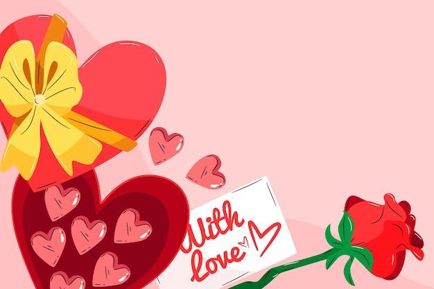 Fondo de san valentín con chocolates en forma de corazón y rosa