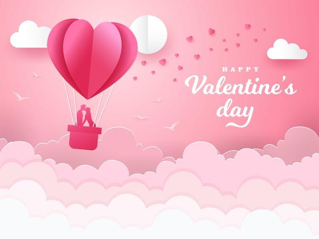 Fondo de san valentín con pareja romántica besándose y de pie dentro de una canasta de un globo de aire. ilustración de vector de estilo de corte de papel