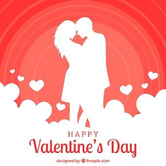 Fondo de san valentín con silueta de pareja besando