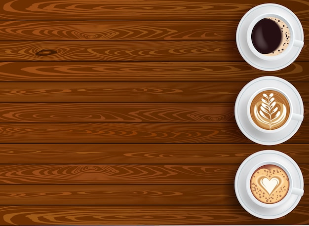 Fondo con tres tazas de café en la vista superior de la mesa de madera con lugar para texto editable