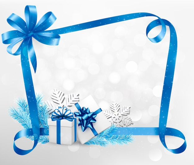 Fondo de vacaciones de año nuevo y navidad con cajas de regalo coloridas en una cinta azul.