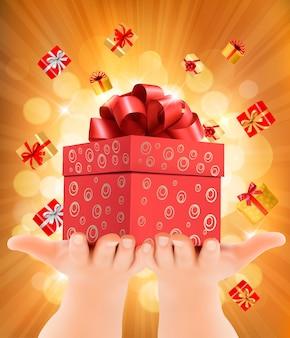 Fondo de vacaciones con manos sosteniendo cajas de regalo