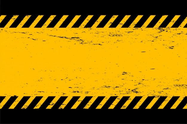 Fondo vacío abstracto amarillo y negro del estilo del grunge