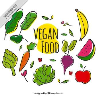 Fondo de variedad de comida vegana dibujada a mano