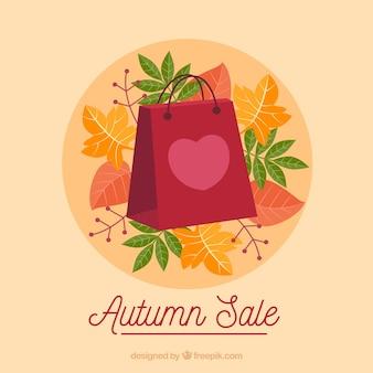 Fondo de venta de otoño con bolsa de compra