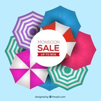 Fondo de venta de temporada monzón con paraguas coloridos