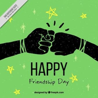 Fondo verde de amistad con manos en estilo vintage