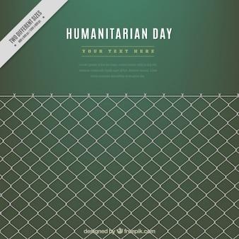 Fondo verde del día humanitaria con una verja
