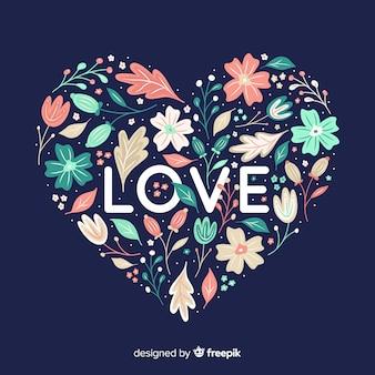 En forma de corazón con flores sobre fondo azul.
