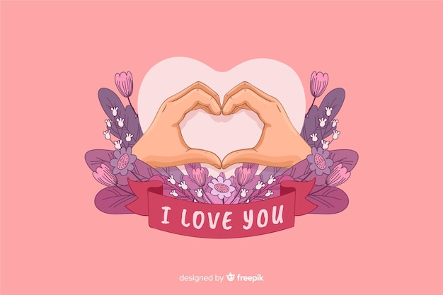 En forma de corazón hecho con manos y te amo cinta