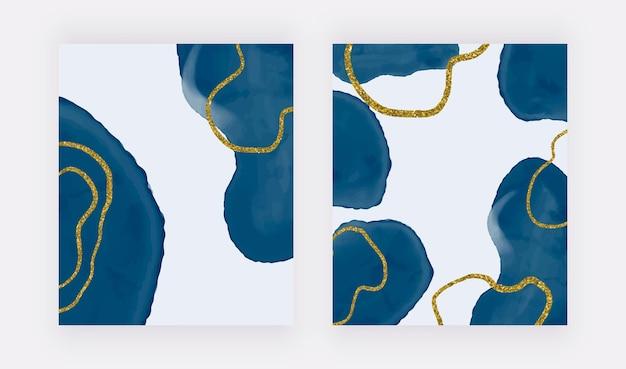 Formas de trazo de pincel azul a mano alzada y líneas de brillo dorado