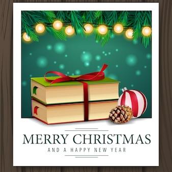 Foto con libros de navidad y saludos feliz navidad.