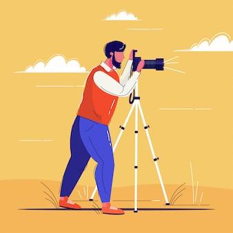 Fotógrafo profesional tomando foto hombre disparando con cámara digital réflex digital sobre trípode de cuerpo entero plana