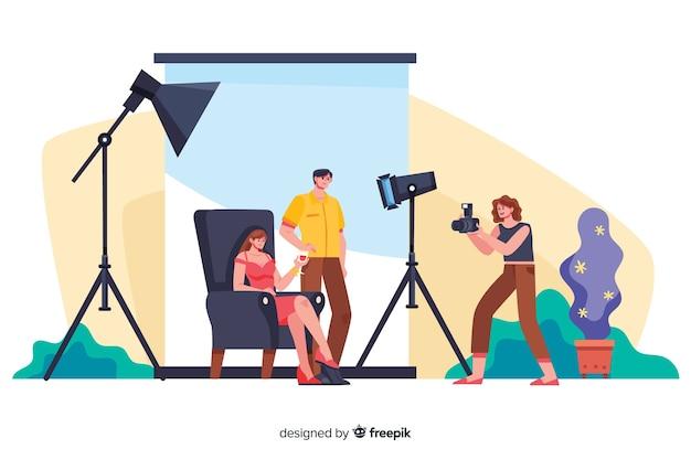 Fotógrafos de dibujos animados que trabajan con modelos