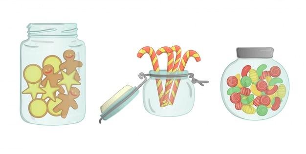 Frascos de vidrio con galletas, bastones de caramelo, pan de jengibre, dulces